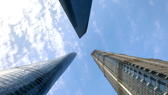 view of jin mao tower and shanghai tower and swfc at daytime in shanghai, china - jin mao tower stock videos & royalty-free footage