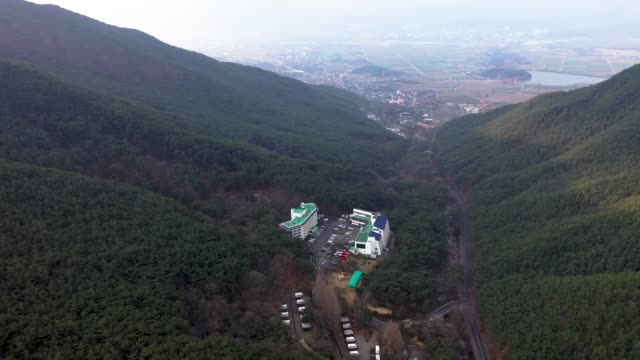 view of jirisan mountain condo around hwaomsa temple(it is a head temple of the jogye order of korean buddhism) in gurye, jeollanam-do province - jeollanam do stock videos & royalty-free footage