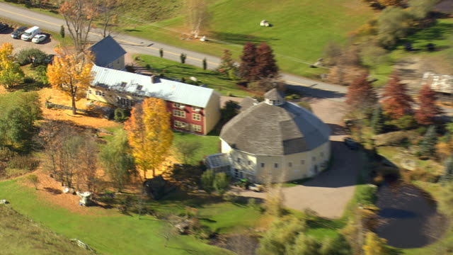 ms aerial ds zi view of jocelyn round barn / vermont, united states - vermont stock videos & royalty-free footage