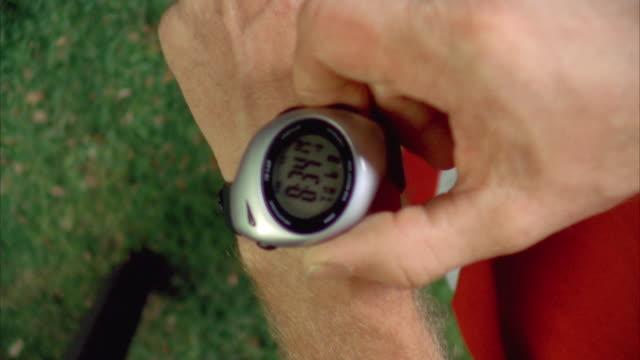 ms zo slo mo view of jogger's wrist watch / johnson city, texas, usa - johnson city texas stock videos & royalty-free footage