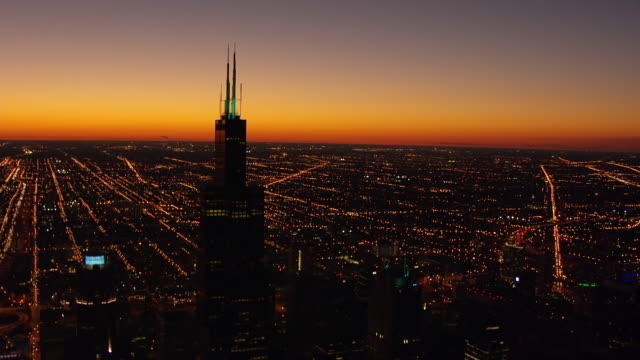 WS AERIAL POV View of John Hancock Tower with cityscape at night / Chicago, Cook County, Illinois, United States