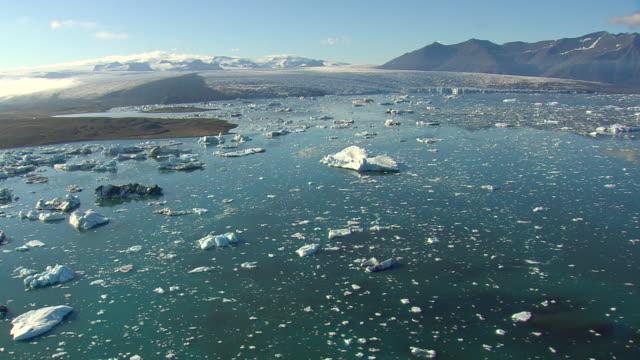 WS AERIAL View of Jokulsarlon icebergs / Iceland