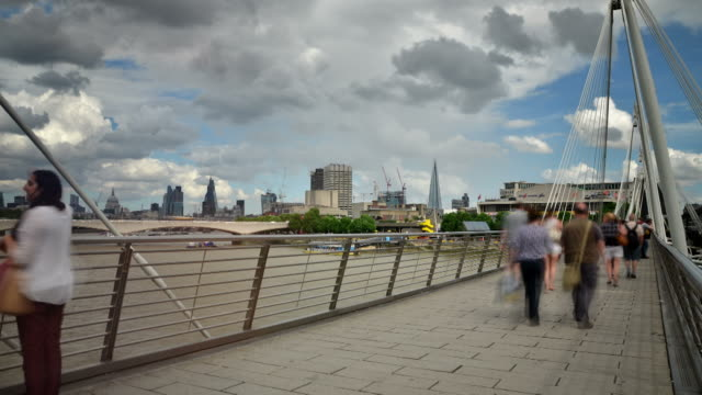 ws t/l view of jubilee bridge on thames north and south london with national theatre and waterloo bridge / london, greater london, united kingdom - greater london stock videos & royalty-free footage