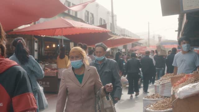 view of kashgar international grand bazaar(market) kashgar, xinjiang, china - walkable city stock videos & royalty-free footage