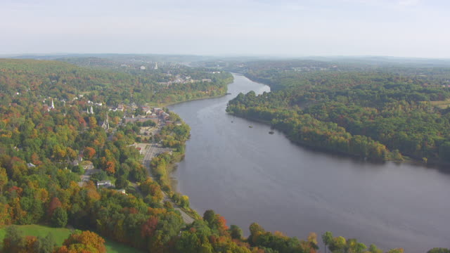 ws aerial pov view of kennebec river with houses/ augusta, maine, united states - augusta maine stock videos & royalty-free footage