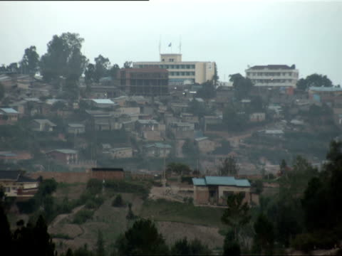ws view of kigali residential neighborhood with international criminal tribunal of rwanda on hill in background / kigali, rwanda - genocide stock videos & royalty-free footage