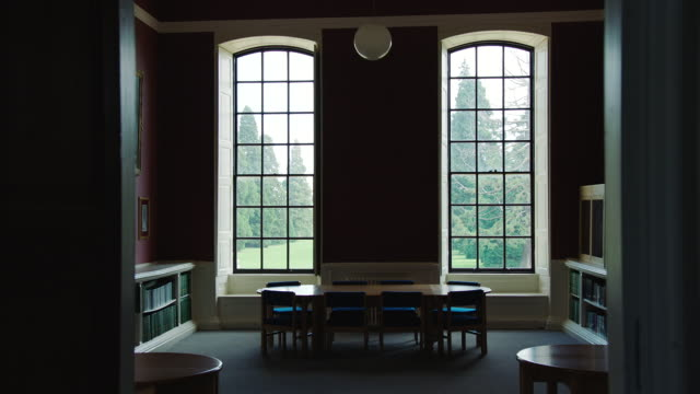 MS View of Kimbolton School library and windows looking out to countryside / Cambridgeshire, United Kingdom