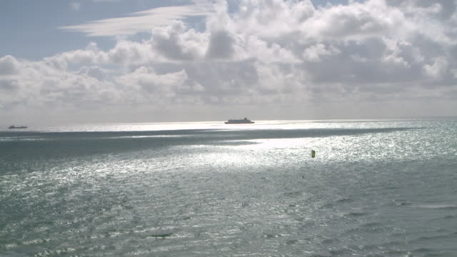WS View of Kite surfer with cruiseship in distance / Miami Beach, Florida, United States