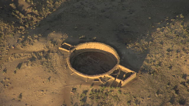 ws aerial td view of kiva ruins at chaco canyon national historical park / new mexico, united states - chaco culture national historical park stock videos & royalty-free footage