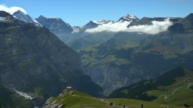 view of kleine scheidegg to lauterbrunnen valley, bernese alps, switzerland, europe - alpen stock-videos und b-roll-filmmaterial
