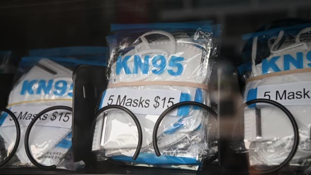 view of kn95 protective masks for sale in a personal protective equipment vending machine on the lower east side of manhattan during the coronavirus... - protective workwear stock-videos und b-roll-filmmaterial