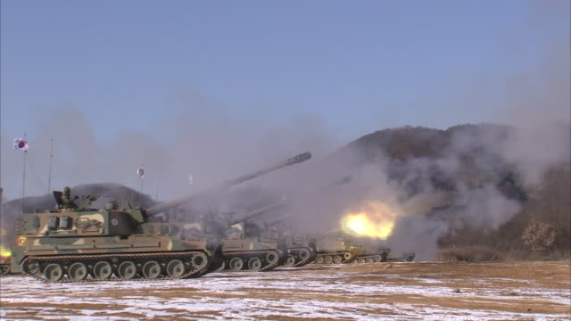 view of korea army tanks hanging korean flag shooting - shooting a weapon stock videos & royalty-free footage
