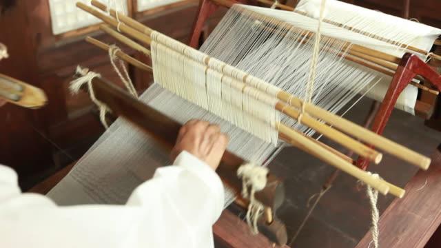 view of korean woman weaving ramie on a loom at hansan mosi (ramie fabric) museum - einzelne frau über 40 stock-videos und b-roll-filmmaterial