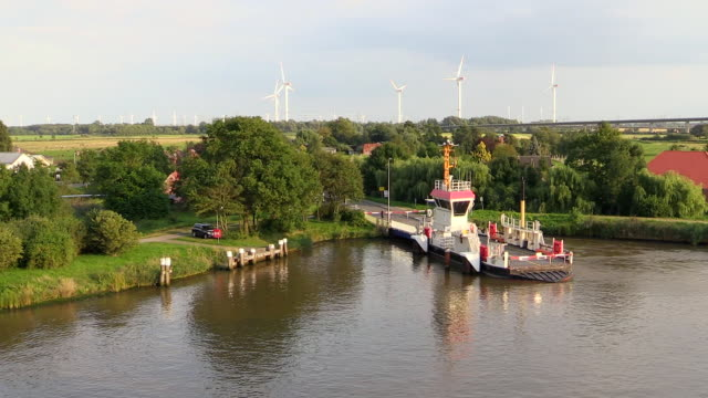 ws pov view of kudensee ferry on kiel canal near brunsbuttel, schleswig holstein / hamburg, germany - schleswig holstein stock videos & royalty-free footage