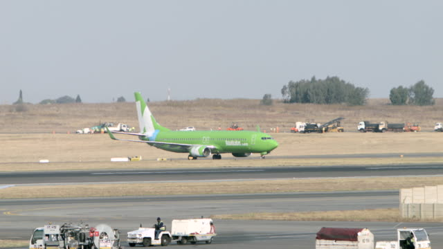 WS View of Kulula Arways 737-800 crosses taxiway / Johannesburg, Gauteng, South Africa