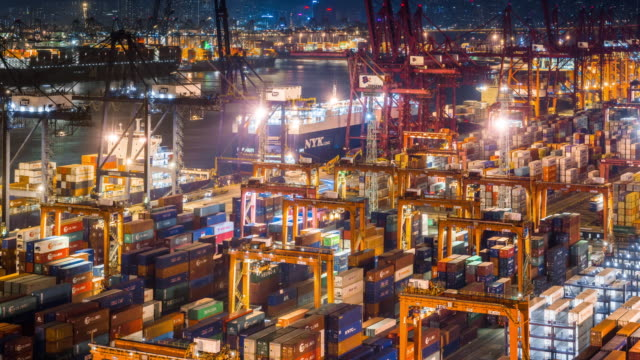 t/l ms ha zo view of kwai tsing container terminal at night / hong kong, china - attrezzatura industriale video stock e b–roll