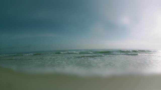 ws view of laguna beach with surfers / laguna beach, california, usa - kelly mason videos stock-videos und b-roll-filmmaterial