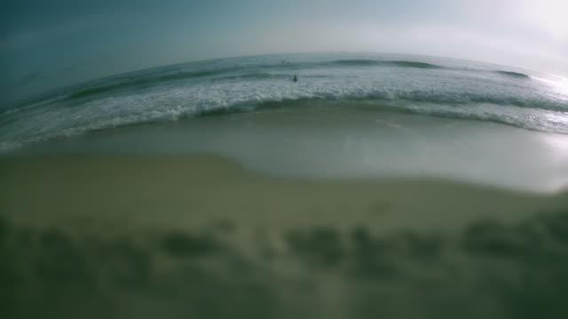 ws view of laguna beach with surfers / laguna beach, california, usa - kelly mason videos stock videos & royalty-free footage