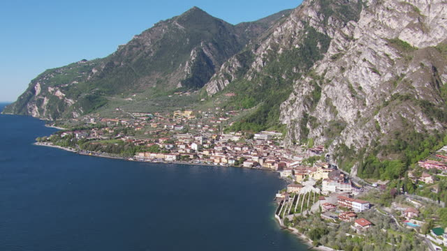WS AERIAL ZI View of lake and mountains with boats on harbor / Lake Garda, Trentino, Verona, Brescia