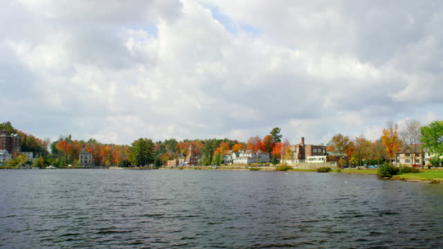 WS View of lake and town in autumn / Saranac Lake, New York, United States