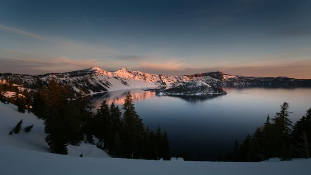 ws t/l pan view of lake at sunrise / crater lake np, oregon, united states - crater lake oregon stock videos & royalty-free footage