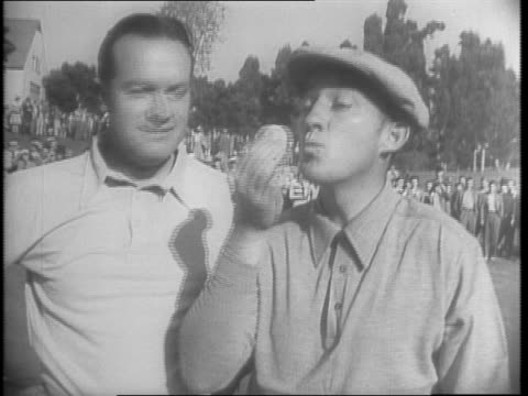 View of Lake Chabot Golf Course in Oakland CA / Bing Crosby and Bob Hope and workers on course / Hope and Crosby's game and antics including trick...