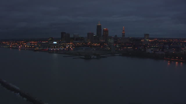 ws aerial view of lake erie approaching downtown / cleveland, ohio, united states - cleveland ohio stock videos & royalty-free footage