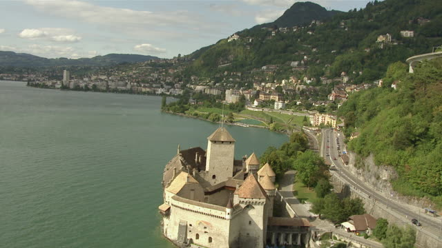 ws aerial view of lake geneva and building on lake side / veytaux (montreux), switzerland - montreux stock videos & royalty-free footage