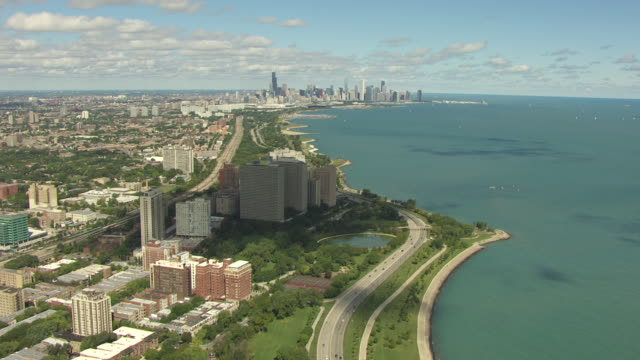 WS AERIAL POV View of Lake Michigan coastline, cityscape in background / Chicago, Illinois, United States