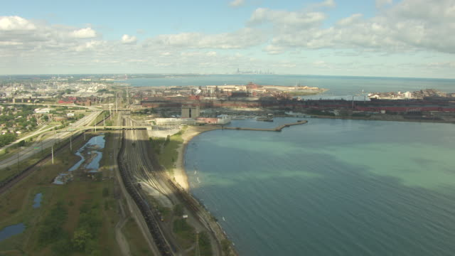 WS AERIAL POV View of Lake Michigan coastline, steel mill in background / Gary, Indiana, United States