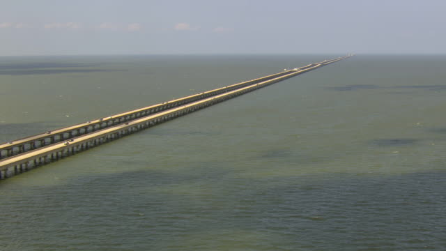 WS AERIAL View of lake ponchartrain causeway with cars driving / Louisiana, United States