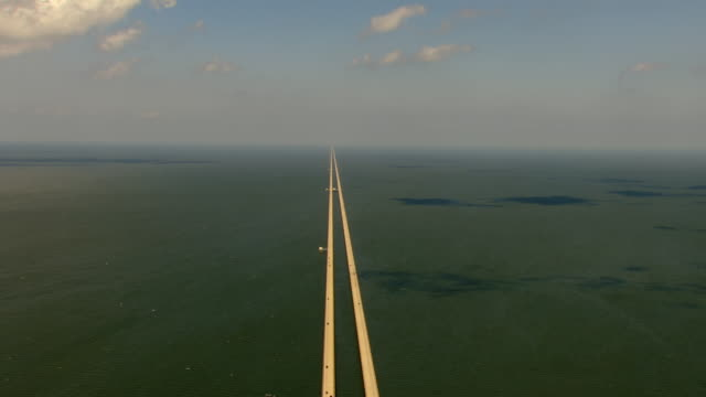 WS AERIAL View of lake pontchartrain causeway with cars driving / Louisiana, United States