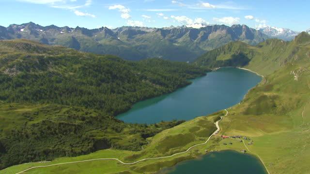 WS AERIAL View of lake ritom and cadagno in piora valley / Lake Ritom, Ticino, Switzerland
