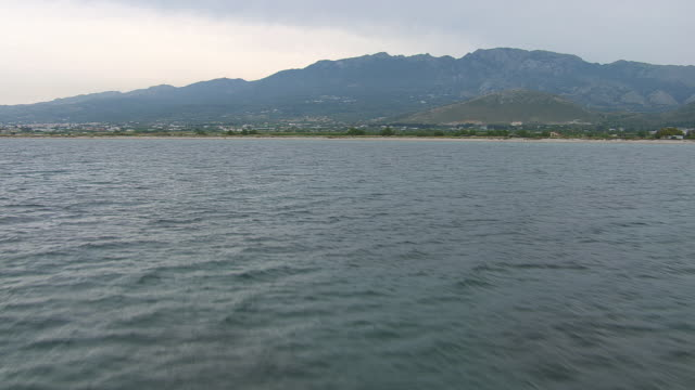 WS AERIAL View of lake to ocean with mountains / Kos, Dodecanese, Greece