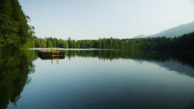 WS View of lake with floating raft / Squamish, British Columbia, Canada