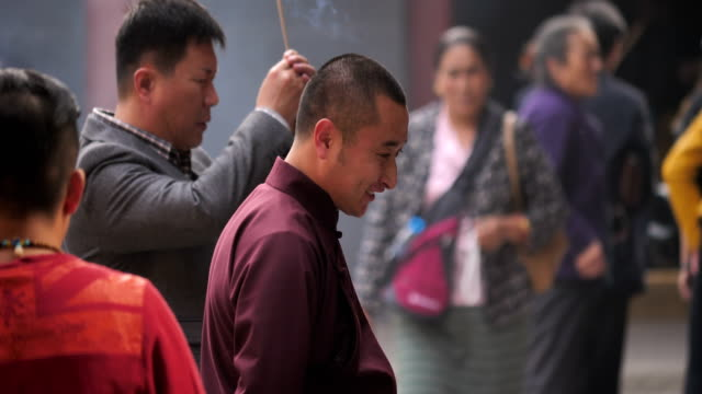 a view of lama in the famous lama temple on oct 20 2017 in beijing china - monk stock videos and b-roll footage