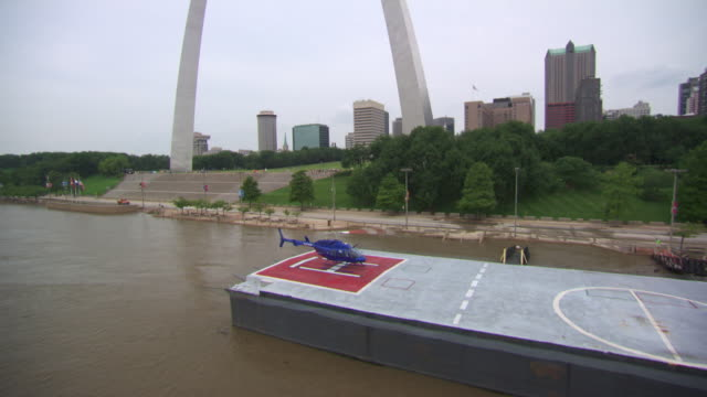 aerial ms zi view of landed helicopter on boat near gateway arch and landing on boat / st louis, missouri, united states  - jefferson national expansion memorial park stock videos & royalty-free footage