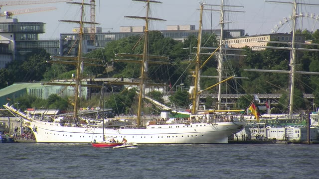 WS View of Landsbrücken sail ships Gorch Fock and Rickmer Rickmers in river Elbe / Hamburg, Germany