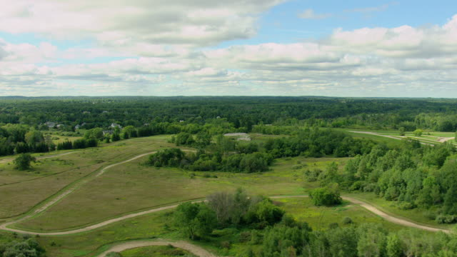 ws aerial view of landscape and tracks at michigan proving groundss / romeo, michigan, united states - michigan stock videos and b-roll footage