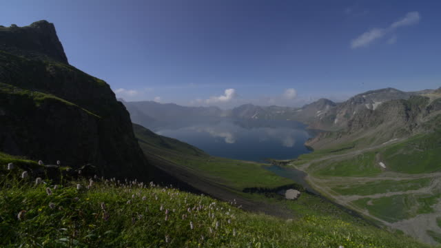 View of landscape of Cheonji (the crater lake of mountain peak) and Dalmun (the only point of exit of the lake) at Baekdu Mountain on the border of North Korea and China