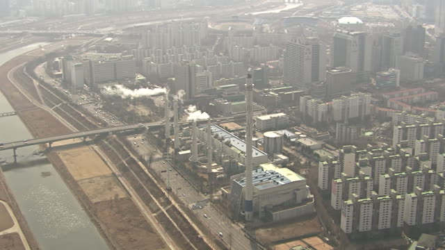 ws aerial view of landscape of residential districts and thermal power plant at mok dong seoul / seoul, south korea - mok stock videos and b-roll footage