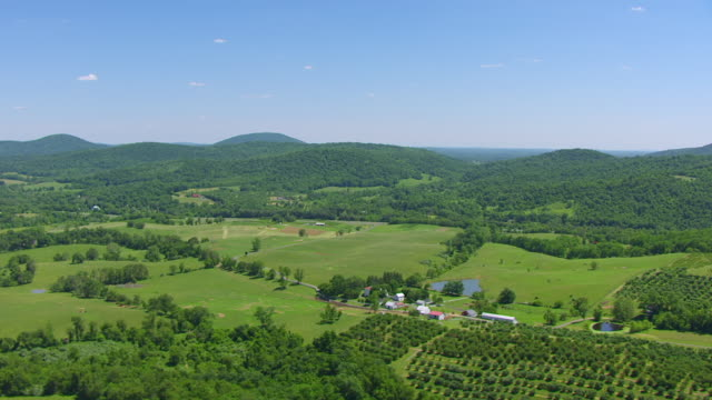 WS AERIAL POV View of landscape with green fields and small homes / Virginia, United States