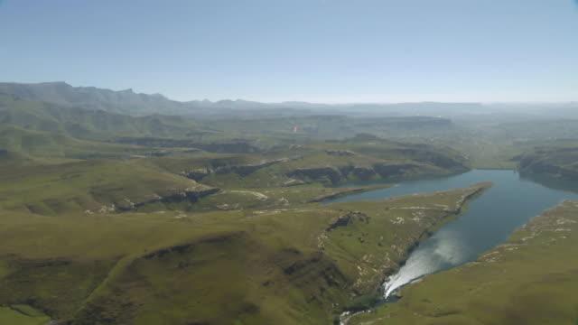 ws aerial view of landscape with lake / kwazulu natal, south africa - drakensberg mountain range stock videos & royalty-free footage