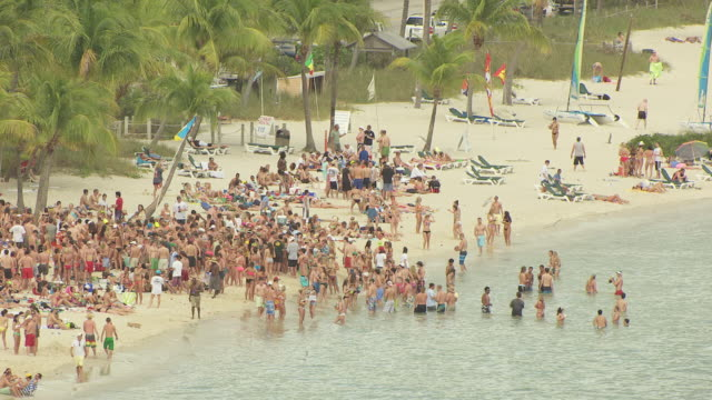ms aerial zo view of large beach party at smathers beach / key west, florida, united states - key west stock videos & royalty-free footage