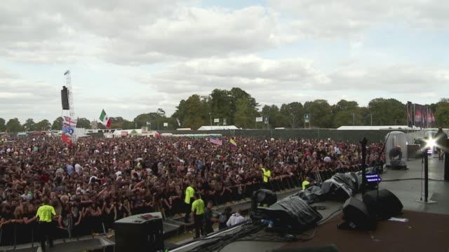 WS SLO MO PAN View of large crowd at music festival / Knebworth, Hertfordshire, UK