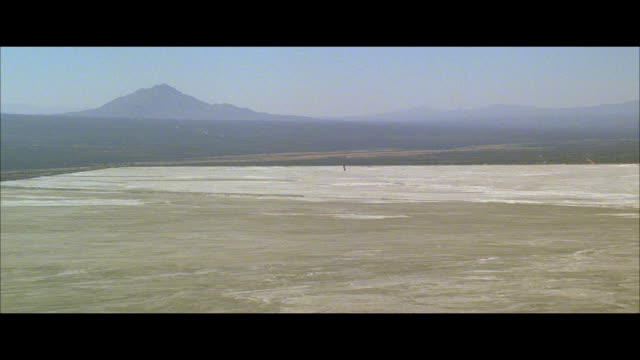 ws pov view of large dry lake bed - breitwandformat stock-videos und b-roll-filmmaterial