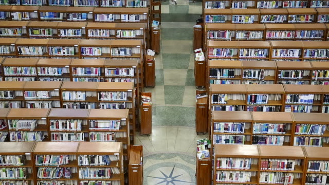 view of large group of books and bookshelves at the library of kyunghee university - bibliothek stock-videos und b-roll-filmmaterial