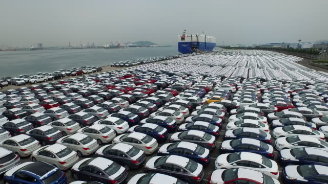View of large group of cars parking in a row at export pier