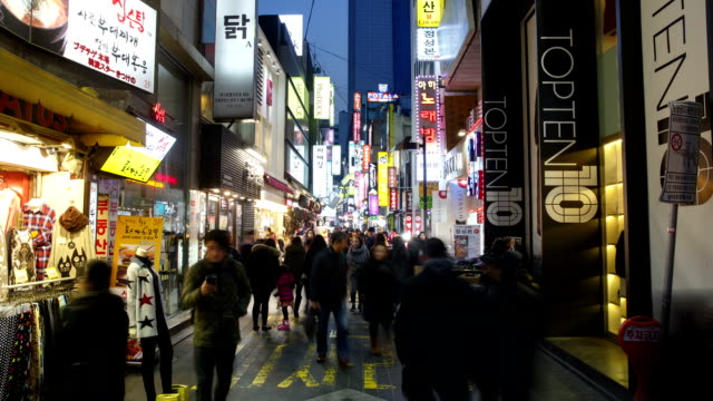 view of large group of people on the myeong dong street (tourist most visited places and one of the primary shopping districts in seoul) at night - western script stock videos & royalty-free footage