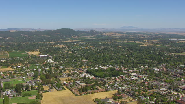 WS AERIAL POV View of large landscape with crowded city, mountain in background / Sonoma, California, United States